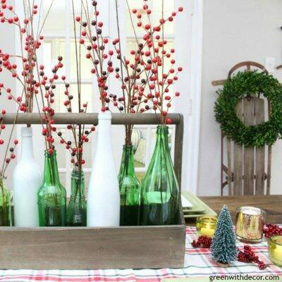 A plaid Christmas centerpiece and tablescape. Love those pretty bottles and that vintage sled!
