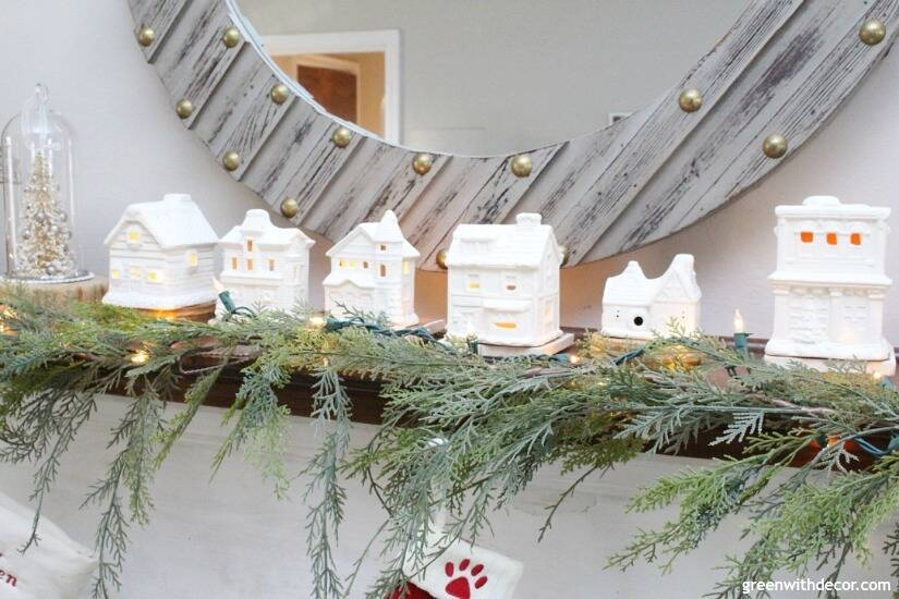 A simple Christmas mantel with village pieces, love how these look like real ceramic! Such a cute easy mantel decorating idea!