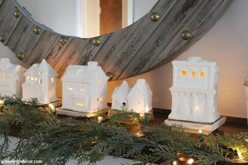An easy DIY Christmas village! A simple Christmas mantel with village pieces, love how these look like real ceramic! Such an easy mantel decorating idea and so cozy at night!