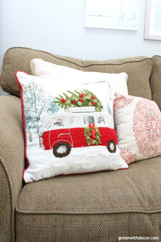 A traditional Christmas living room filled with red, green and metallic decor. Such a cute Christmas pillow with the black dog driving the red Christmas van!