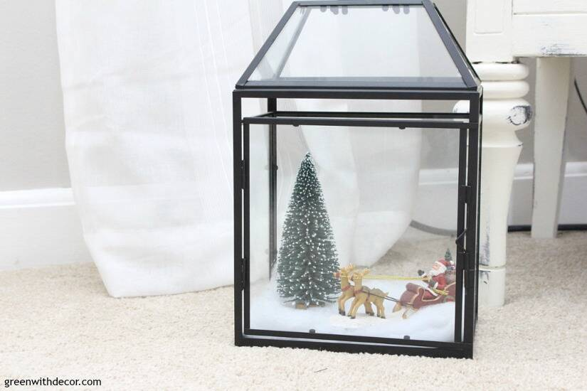 A traditional Christmas living room filled with red, green and metallic decor. Fill glass lanterns with faux snow, mini Christmas trees and little figurines for a mini Christmas village - how cute!