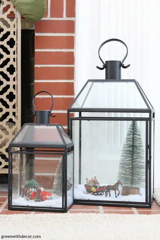 A traditional Christmas living room filled with red, green and metallic decor. Fill glass lanterns with faux snow, mini Christmas trees and little figurines for a mini Christmas village - so cute!