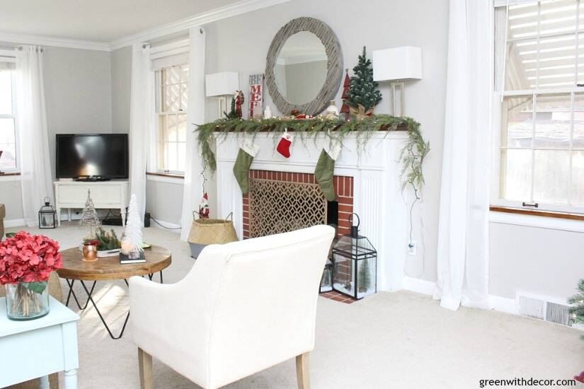 A traditional Christmas living room filled with red, green and metallic decor. Love all of the festive, budget-friendly, easy touches in this living room!