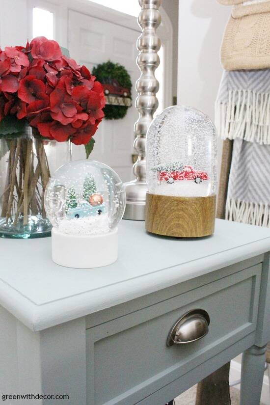 A traditional Christmas living room filled with red, green and metallic decor. Such cute snow globes!