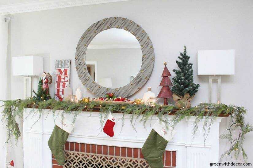 A traditional Christmas mantel - full of red, green, metallic and neutral pieces. Love the faux garland with that gray wood mirror!
