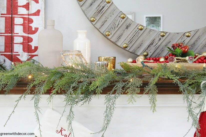 A traditional Christmas mantel - full of red, green, metallic and neutral pieces. Love that faux garland with the metallic candles!