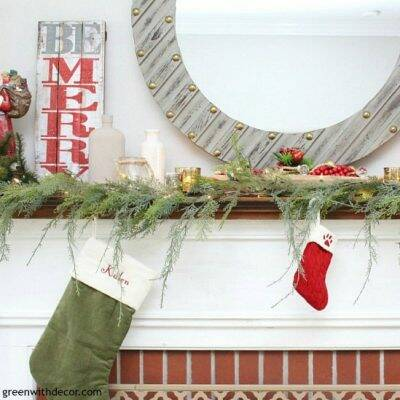 A traditional Christmas mantel - full of red, green, metallic and neutral pieces. Love that farmhouse rustic Be Merry sign!