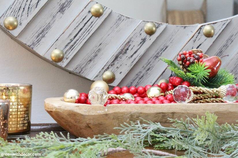 A traditional Christmas mantel - full of red, green, metallic and neutral pieces. Love the faux garland with this bread bowl!