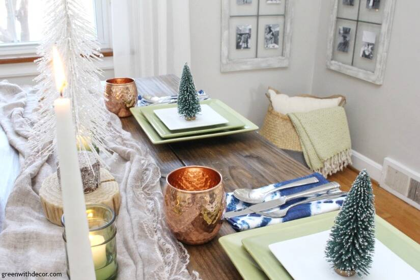 A blue and copper Christmas centerpiece + tablescape - perfect for a costal tablescape! Love that pretty seagrass basket in the corner!