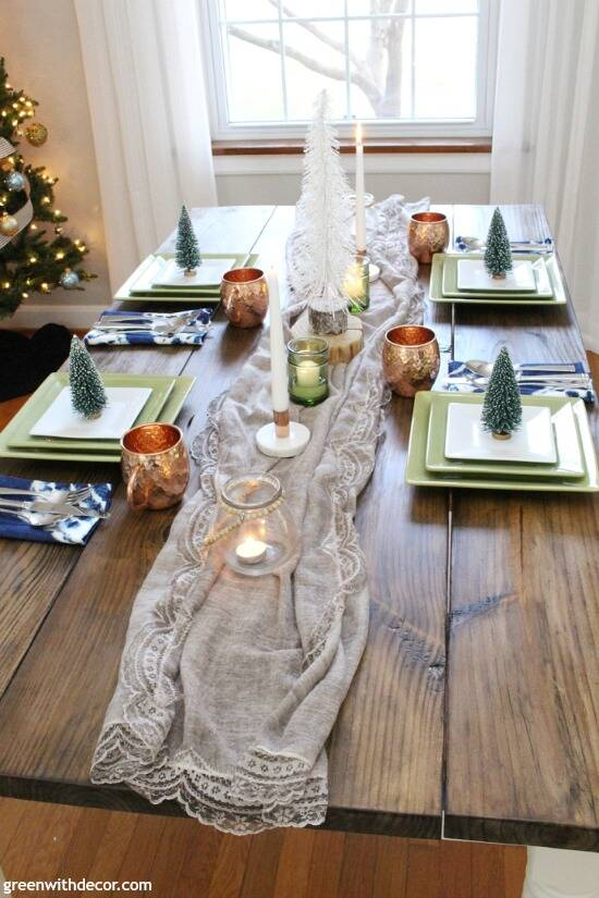 A blue and copper Christmas centerpiece + tablescape - perfect for a costal tablescape! Such a cute (and cheap) idea to use a pretty scarf as a table runner for Christmas!