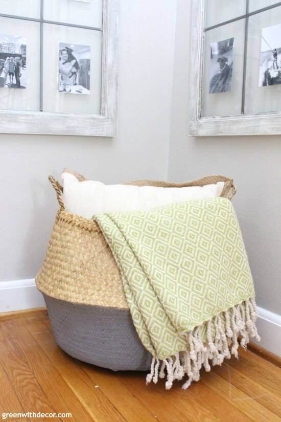 Such a pretty coastal seagrass and gray basket, the green blanket and white pillow look great inside - such easy decorating for a corner!