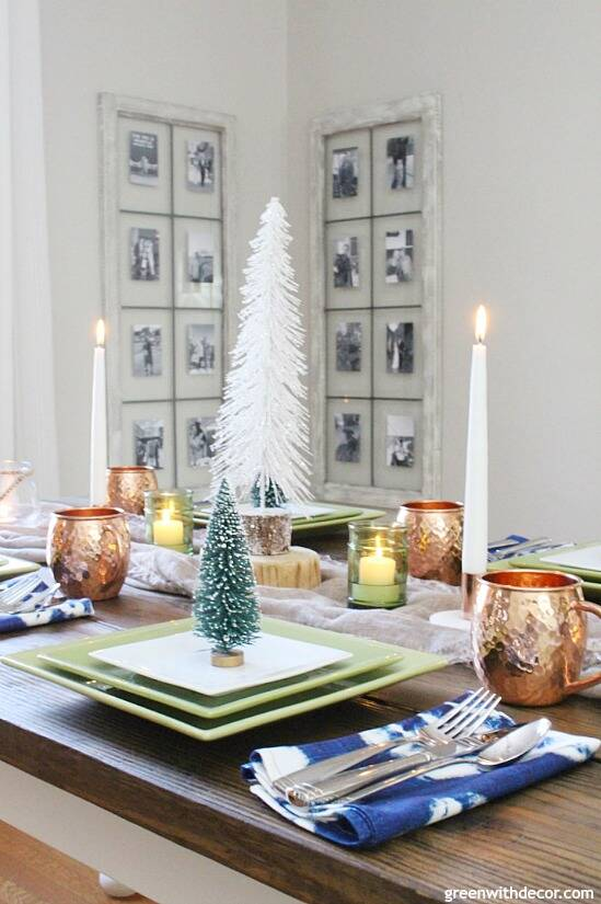 A blue and copper Christmas centerpiece + tablescape - perfect for a costal tablescape! Love that sparkly white mini tree and all of the candles in the center of the table - perfect for the holidays!