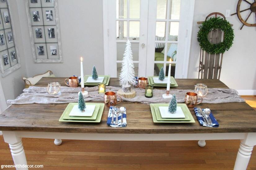 A blue and copper Christmas centerpiece + tablescape - perfect for a costal tablescape! Love the mixture of beachy pieces with metallic mugs and candleholders!