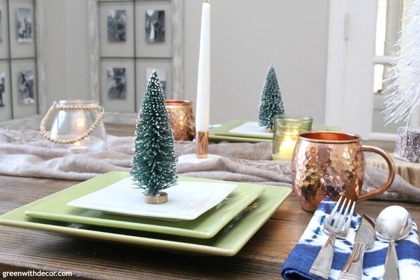 A blue and copper Christmas centerpiece + tablescape - perfect for a costal tablescape! Love those cute little mini Christmas trees at each place setting!