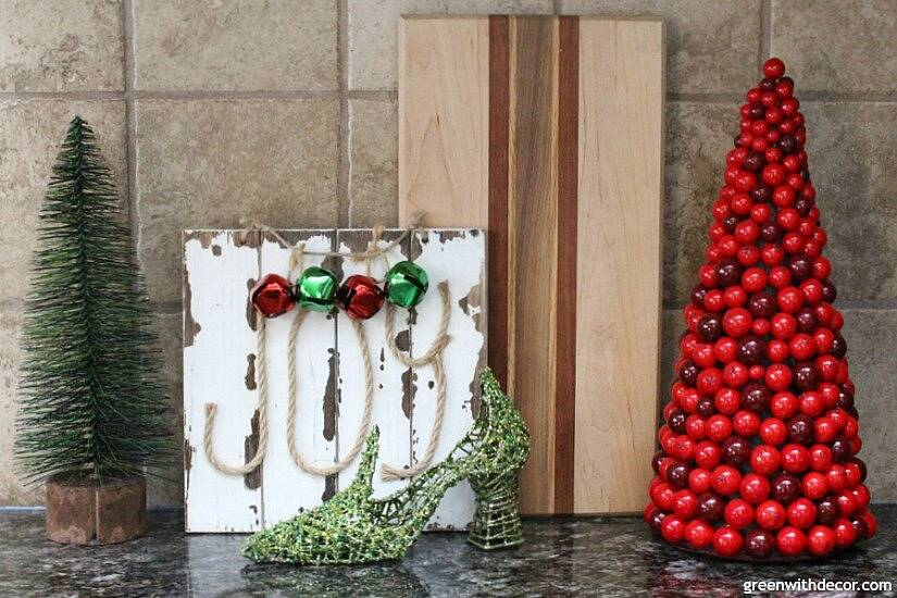 Christmas decorating in a big window box and more Christmas ideas for the kitchen counters. Cute mini Christmas trees!