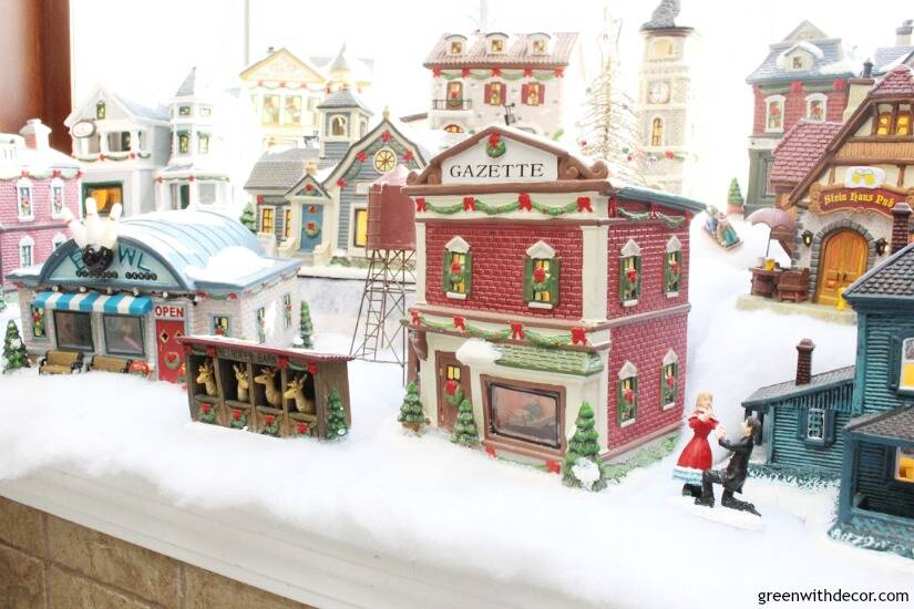 Christmas decorating in a big window box - smart space for a cute Christmas village!