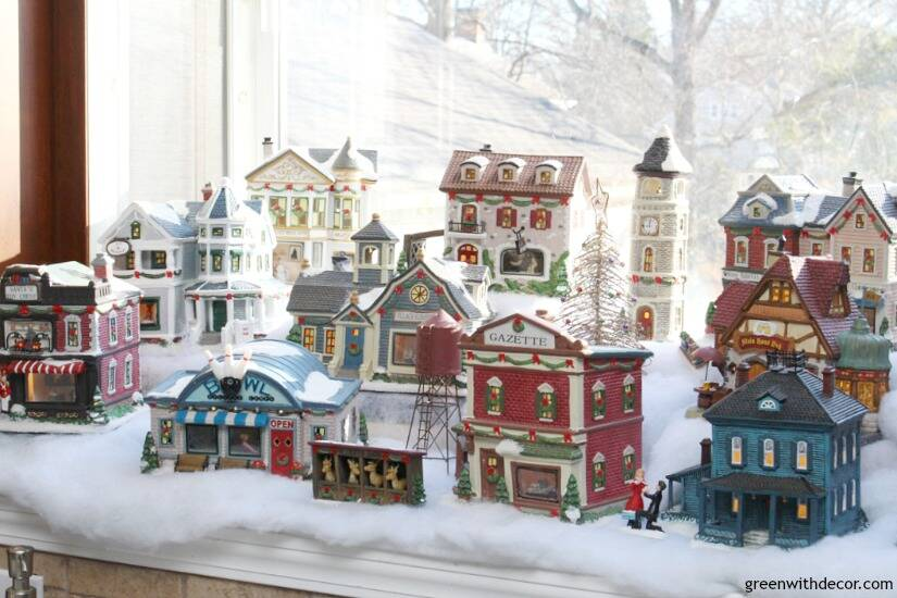 Christmas decorating in a big window box - perfect space for a cute Christmas village!