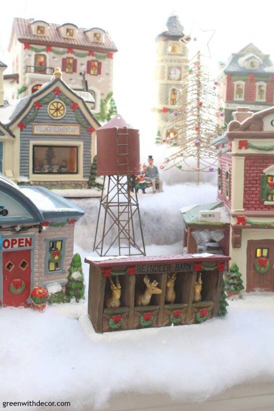 Christmas decorating in a big window box - perfect spot for a cute Christmas village!