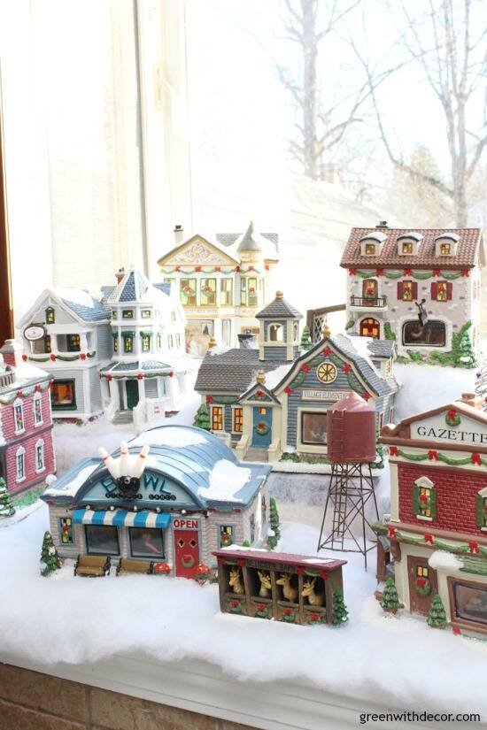 Christmas decorating in a big window box - great space for a cute Christmas village!