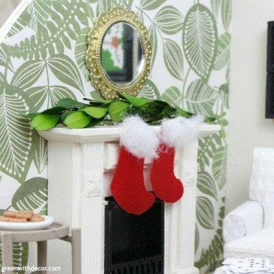 A miniature Christmas living room. Such cute and festive DIY dollhouse ideas for Christmas!