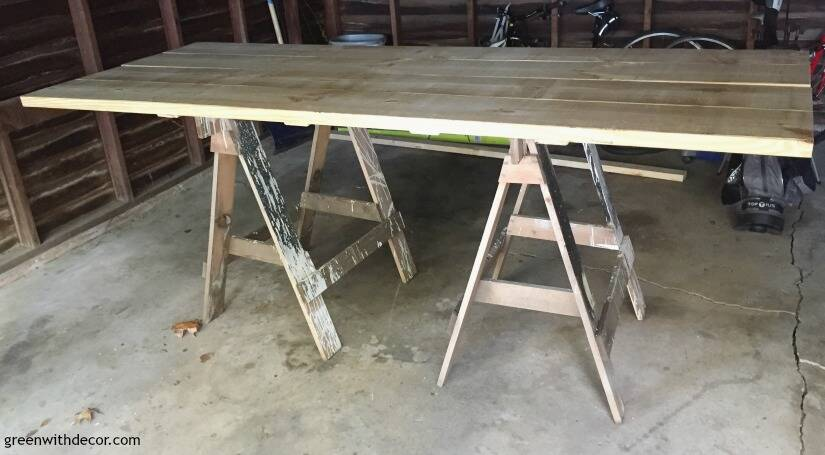 How to build a farmhouse dining table from start to finish - use sawhorses to prop up the tabletop before you sand it