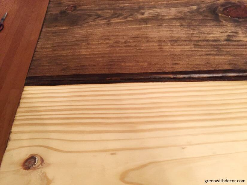 An unfinished wood table in the process of being stained with dark wood stain.