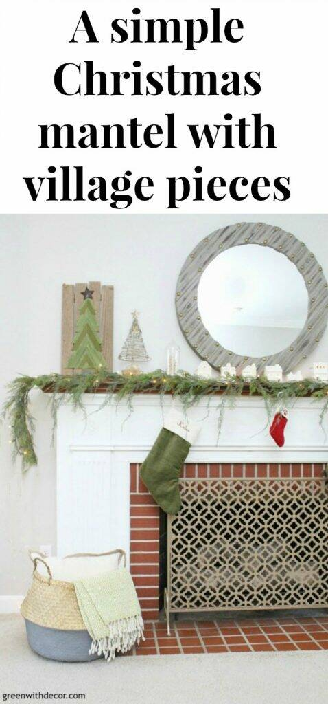 A simple Christmas mantel with village pieces, that faux garland looks real - I love it with the mini Christmas trees and the white Christmas lights! And that gorgeous seagrass basket!