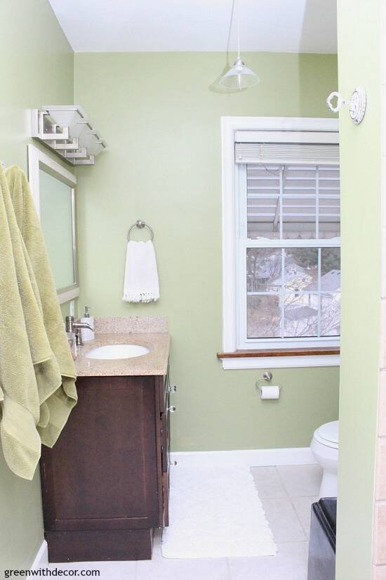 Easy ways to update a bathroom without renovating - if you can't afford a bathroom remodel or are renting, these are great tips for updating your bathroom! Use rugs to cover up a floor you wish you could replace!