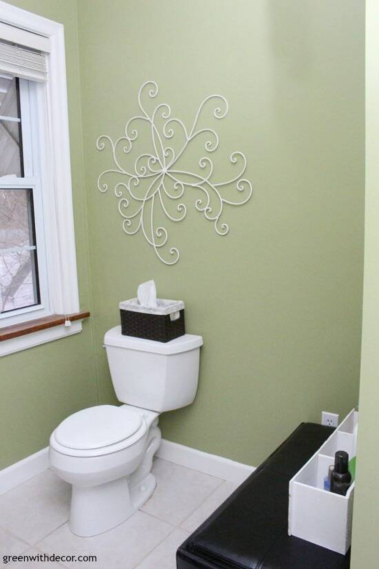 Easy ways to update a bathroom without renovating - if you can't afford a bathroom remodel or are renting, these are great tips for updating your bathroom! New wall art adds some personality to a bathroom!