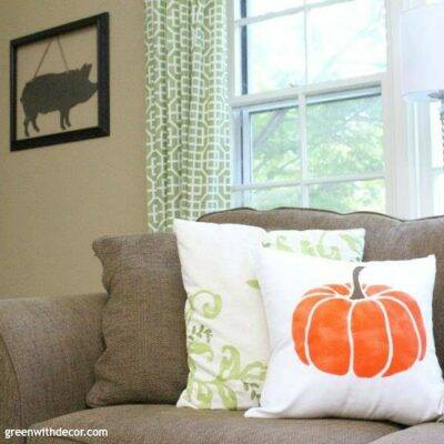 An orange and white fall pumpkin pillow