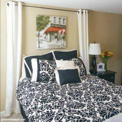 I love this guest room. What a pretty headboard idea!