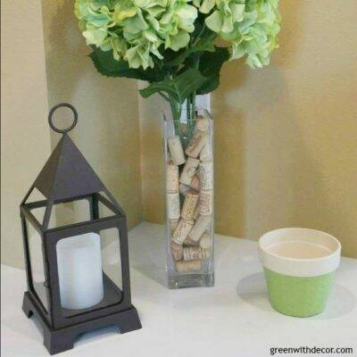 Take a flowerpot that comes with a flower arrangement and spray paint it with a color you like. Then you can reuse the flowerpot!