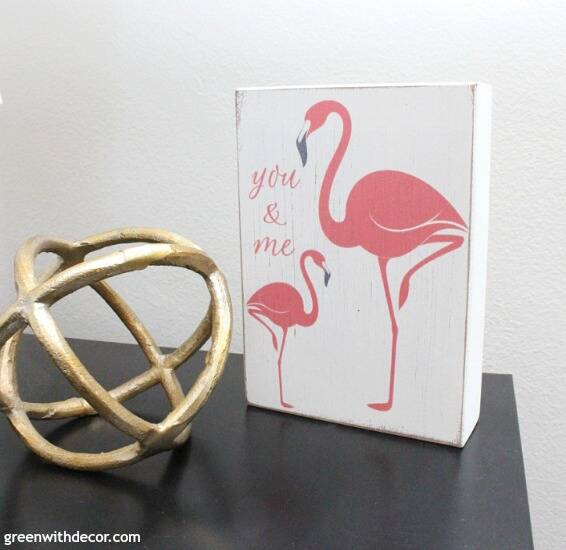 A wood flamingo 'you and me' sign