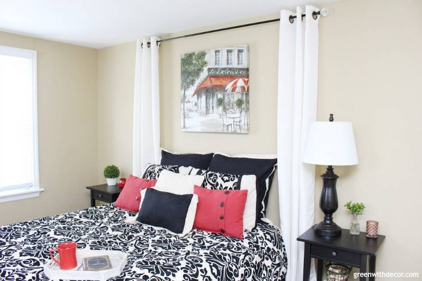 Pretty neutral paint colors - Camelback by Sherwin Williams looks great in this black and red guest bedroom!