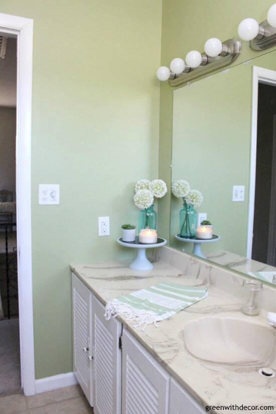 Rental bathroom reveal - green and white bathroom with pretty decor even if you can't remodel!