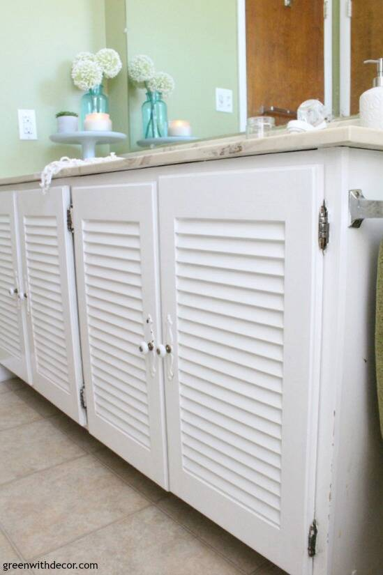 Easy bathroom DIYs - switch out the doors on an old vanity if you can't replace the whole thing right now! New hardware can make such a difference, too!