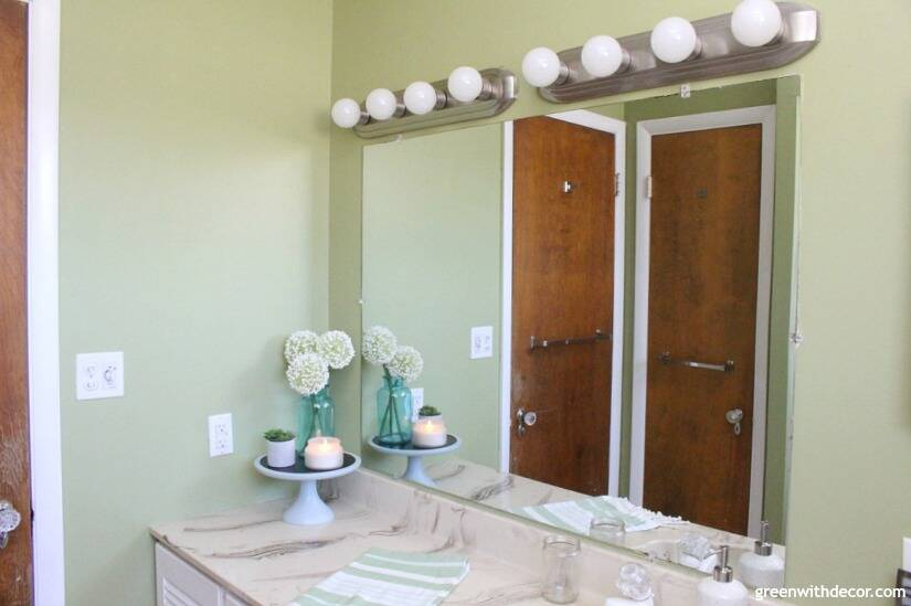 Easy bathroom DIYs - frame a big mirror like this instead of replacing it!