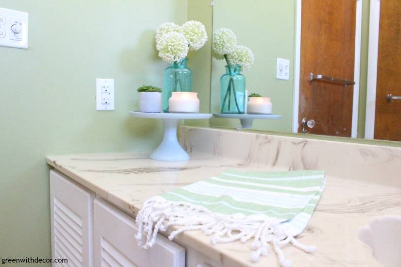 Rental bathroom reveal - cute, easy ideas for a green and white bathroom when you can't remodel!
