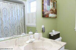 Rental bathroom reveal - fun nightlight and baskets for tissues, and cute little towel!
