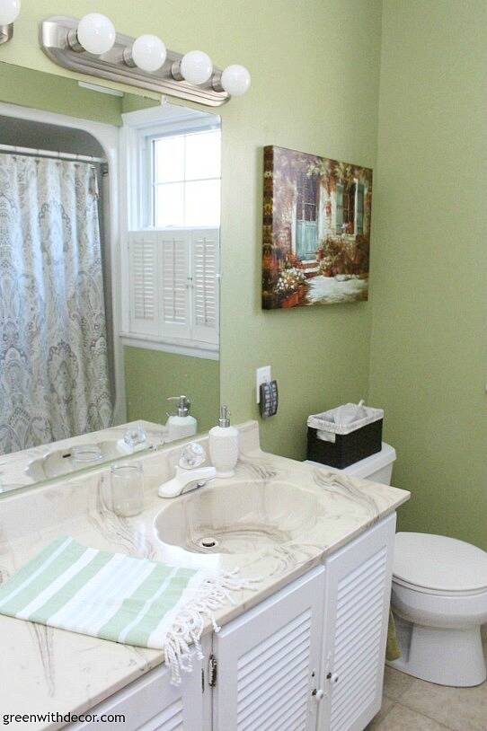 Rental bathroom reveal - fun nightlight and baskets for tissues, and love that little towel!