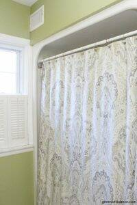 Rental bathroom reveal - a pretty shower curtain is an easy way to add some color and personality!