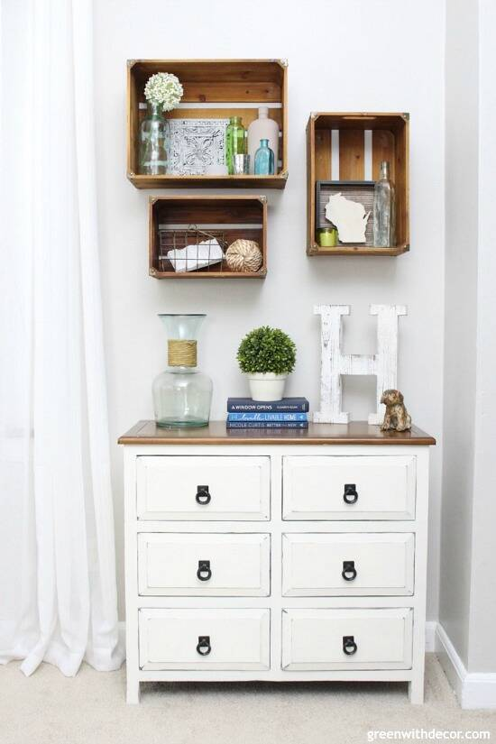 Wood crate shelves above a white dresser
