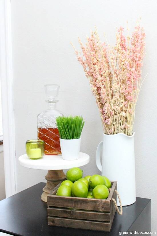 Fun idea to use a white pitcher as a vase for pretty spring flowers. Love the rustic crate full of limes, too!