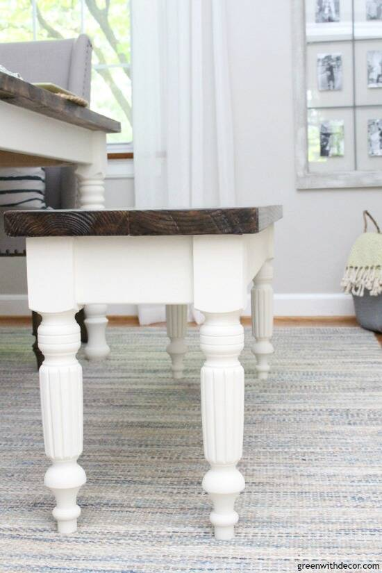 A DIY bench with wood top and white legs