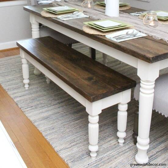 A DIY bench and farmhouse table with dark wood tops and white legs
