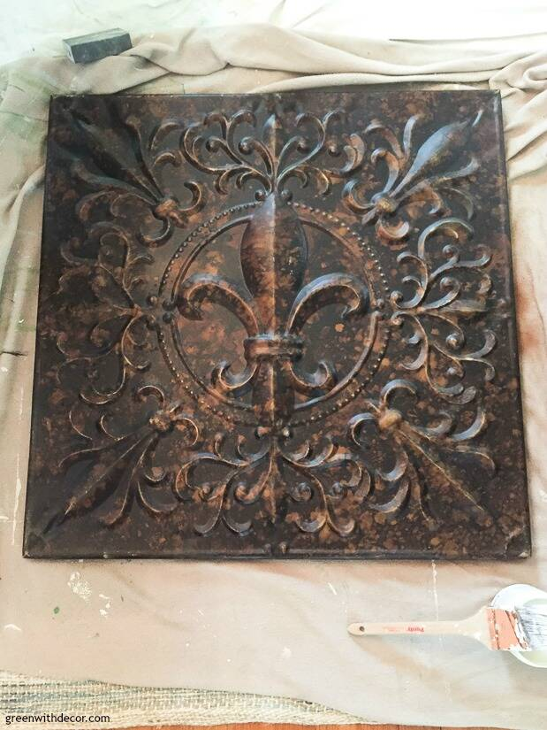 Bronze metal piece before it's painted for a DIY wall art project