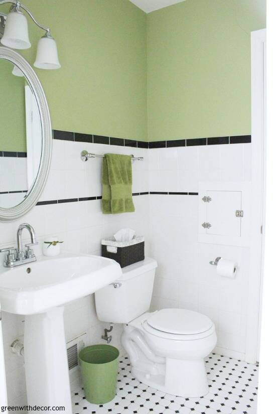 Charming white, green and black powder bathroom