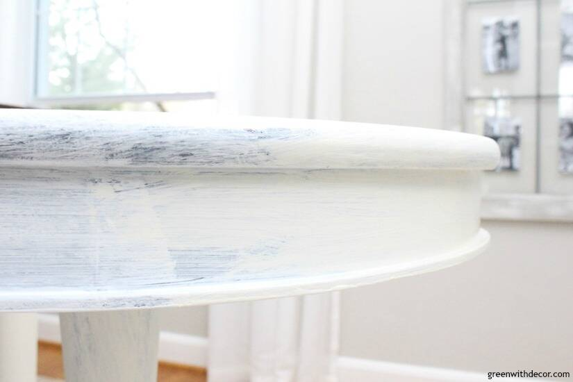 A round table makeover in the middle of being painted