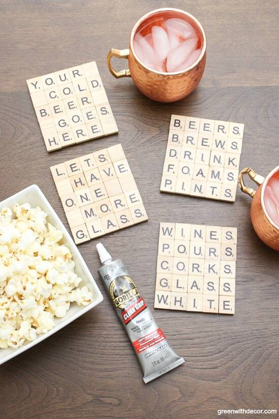Scrabble tile DIY coasters near copper mugs, a bowl of popcorn and Clear Grip
