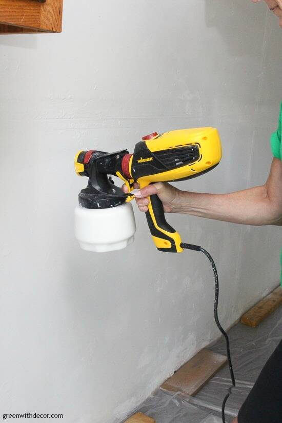 Painting garage walls with a paint sprayer – in process picture